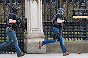 UNITED KINGDOM, London: 22 March 2017 Members of Counter Terrorism Specialist Firearms Officers run outside Parliament after a suspected terror incident outside the Houses of Parliament in Westminster, London earlier today. It is reported that there has been at least one fatality. Rick Findler / Story Picture Agency