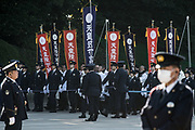 Well-wishers carrying flags are led by Imperial Guard officers as they gather to celebrate Japan's Emperor Akihito's 84th birthday at the Imperial Palace in Tokyo, Japan, December 23, 2017. 23/12/2017-Tokyo, JAPAN