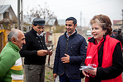 Roma activist Marius Tudor is explaining the importance of political participation which is necessary to bring change. During the last door to door meeting with Roma community members of Marginenii de Jos before the final round of the presidential elections two days later in Romania. The campaigners supported Victor Ponta who lost the presidential elections in the end.