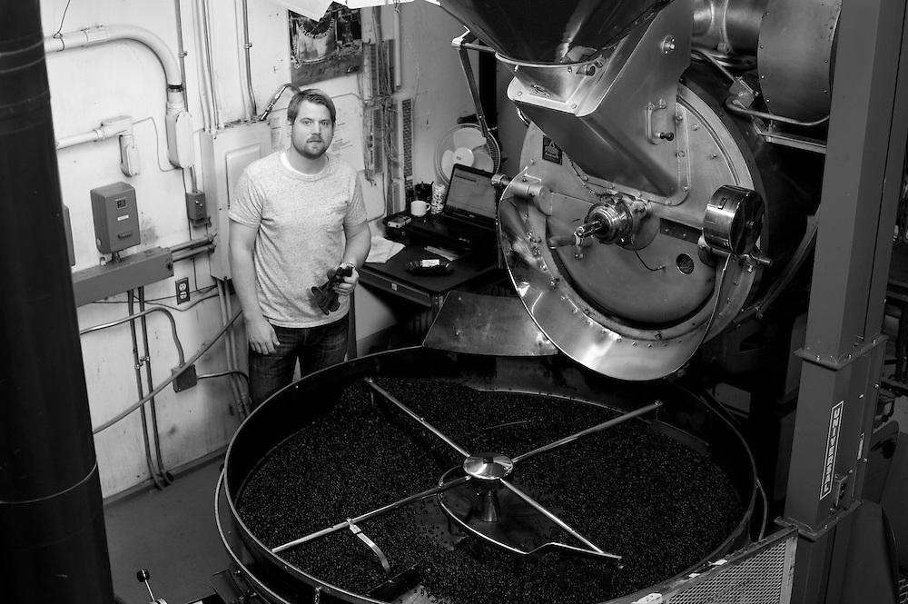 ANCHORAGE, ALASKA - 2013: The roasting process at Cafe Del Mundo.