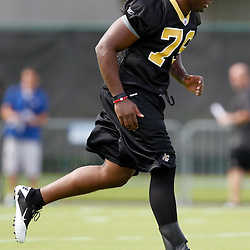 July 29, 2011; Metairie, LA, USA; New Orleans Saints rookie defensive end Greg Romeus (79) runs during the first day of training camp at the New Orleans Saints practice facility. Mandatory Credit: Derick E. Hingle