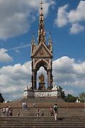 "The Albert Memorial, Kensington Gardens, London, England, north of the Royal Albert Hall. Commissioned by Queen Victoria in memory of her beloved husband, Prince Albert who died of typhoid in 1861. Designed by Sir George Gilbert Scott in the Gothic revival style. Opened in 1872, with the statue of Albert ceremonially ""seated"" in 1875, the memorial consists of an ornate canopy or pavilion containing a statue of Prince Albert facing south. The memorial is 176 feet tall, took over ten years to complete, and cost £120,000."