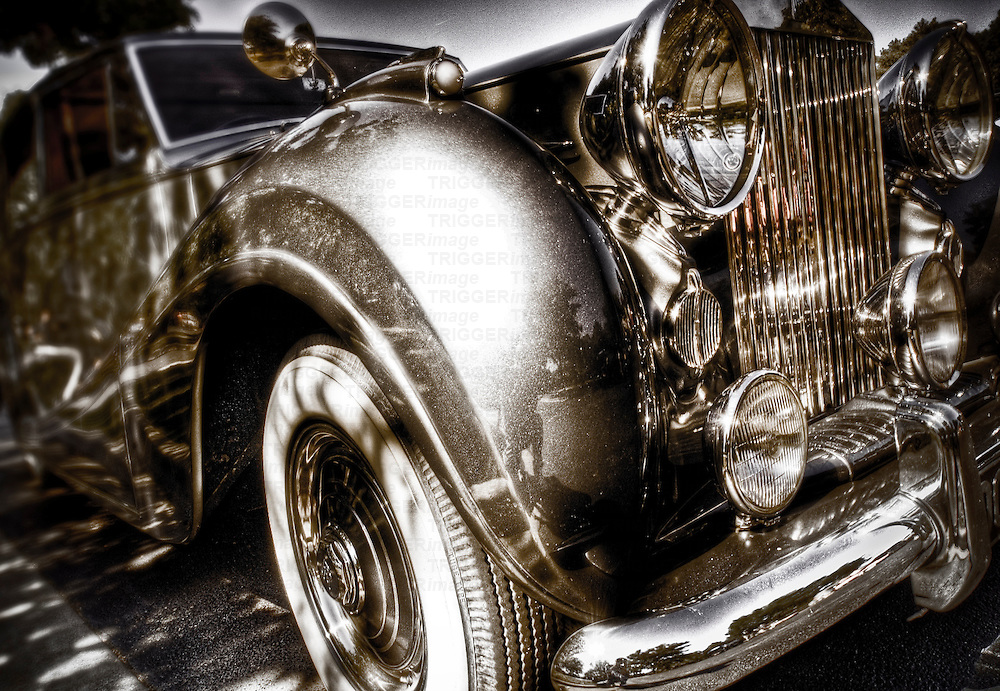 A vintage Rolls Royce motorcar with gleaming chrome grill and bumper