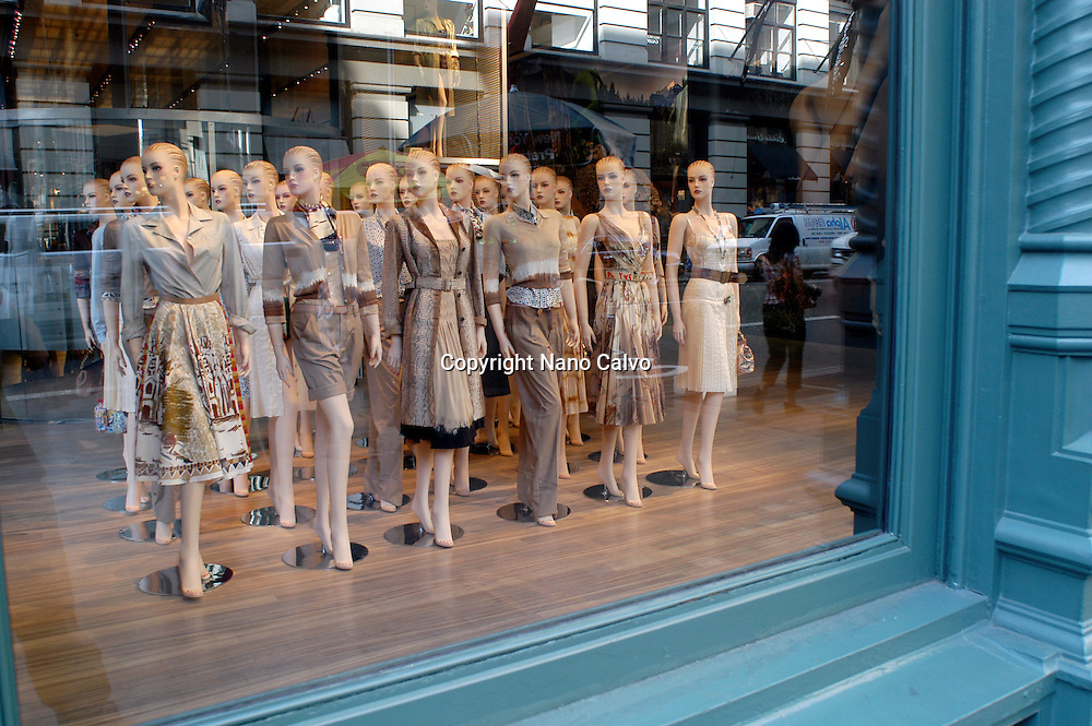 Group of mannekins in display window of a clothes shop, in the Soho area, in downtown NY, Manhattan, New York City