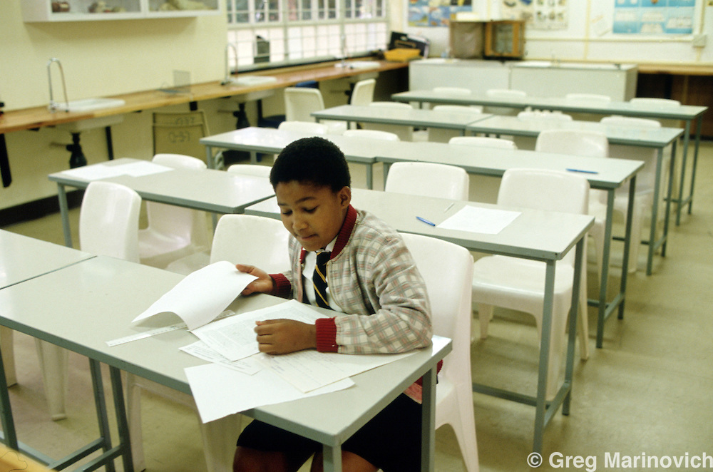 A pupil or learner studies in a classroom. South Africa.