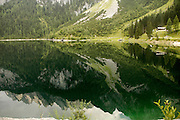 Austria, Upper Austria, Gosau, Lake Gosau in the Dachstein Mountains the mountains reflecting in the calm clear water