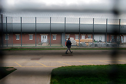 UK ENGLAND NOTTINGHAM 14DEC04 - A prison guard walks through a fenced-off corridor at HMP Lowdham Grange in Nottinghamshire. This newly-built prison is entirely run and controlled by private company Premier-Serco on contract from the Home Office since 1998. The facility holds over 500 Category-B and C inmates with an minimum sentence of 4 years.....jre/Photo by Jiri Rezac....© Jiri Rezac 2004....Contact: +44 (0) 7050 110 417..Mobile:  +44 (0) 7801 337 683..Office:  +44 (0) 20 8968 9635....Email:   jiri@jirirezac.com..Web:     www.jirirezac.com....© All images Jiri Rezac 2004 - All rights reserved.