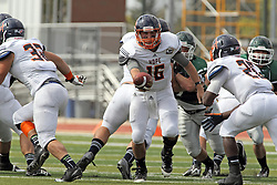 28 September 2013:  Michael Atwell hands off to Shawn Jackson during an NCAA division 3 football game between the Hope College Flying Dutchmen and the Illinois Wesleyan Titans in Tucci Stadium on Wilder Field, Bloomington IL
