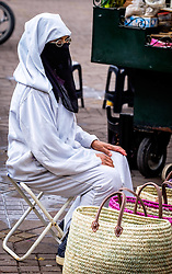 A woman in traditional dress selling baskets in the medina in Marrakech, Morocco, North Africa<br /> <br /> (c) Andrew Wilson | Edinburgh Elite media