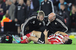 Shane Long of Southampton receives medical treatment - Mandatory byline: Paul Terry/JMP - 07966386802 - 20/08/2015 - FOOTBALL - ST Marys Stadium -Southampton,England - Southampton v FC Midtjylland - EUROPA League Play-Off Round
