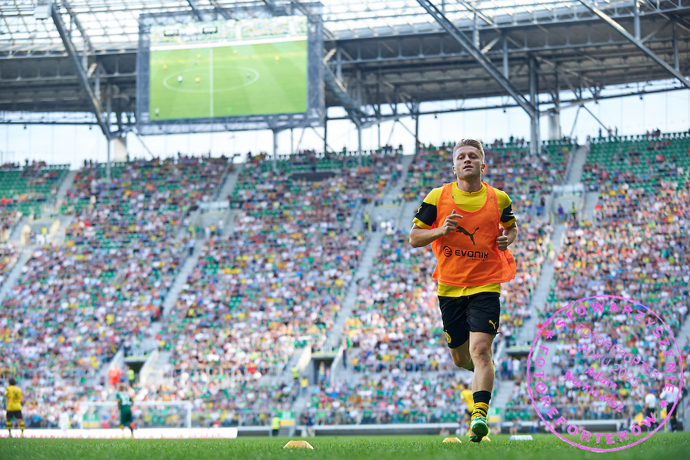 Jakub Blaszczykowski of Dorussia Dortmund whie his warm up before his attend in international friendly soccer match between WKS Slask Wroclaw and BVB Borussia Dortmund on Municipal Stadium in Wroclaw, Poland.<br /> <br /> Poland, Wroclaw, August 6, 2014<br /> <br /> Picture also available in RAW (NEF) or TIFF format on special request.<br /> <br /> For editorial use only. Any commercial or promotional use requires permission.<br /> <br /> Mandatory credit:<br /> Photo by &copy; Adam Nurkiewicz / Mediasport