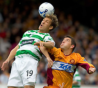 Motherwell v Celtic, Scottish Premier League, Fir Park, Motherwell.  Pic ian Stewart, Saturday 30th July 2005<br /> Phil O'Donnell watches as Stan petrov heads clear