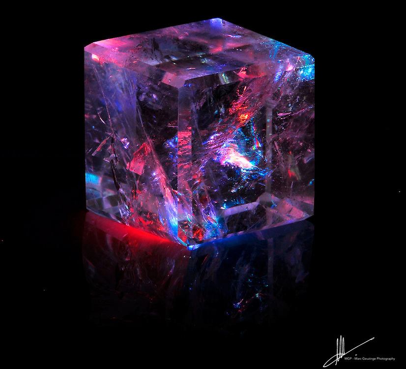 Look, and ice cube on steroids!  ....OK, not quite.......In this Lemurian Quartz cube you can see a marvellous world of inclusions and wisdom , a little universe almost.  This photo is from a private session of custom crystal photography. photo of the day