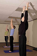 (left to right) Tory Klepacz, from Miami Township; Sarah Fulton, from Beavercreek and Jeff Bonsteel, from Centerville during a yoga class at The Studio, in Beavercreek, Thursday, March 22nd.