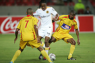 Siphiwe Tshabalala takes on Ryan Chapman and Thabiso Ntloana during the PSL match between Santos and Kaizer Chiefs held at The Nelson Mandela Bay Stadium in Port Elizabeth, Eastern Cape South Africa on 20 November 2009 ..Photo by RG/www.sportzpics.net.+27 21 (0) 21 785 6814