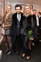 Left to right, ALINA KLYUCHKINA, MARK-FRANCIS VANDELLI and GALINA KLYUCHKINA at a private view of photographs 'Terry O'Neill-The Best Of' held at The Little Black Gallery, 13A Park Walk, London on 16th January 2014.