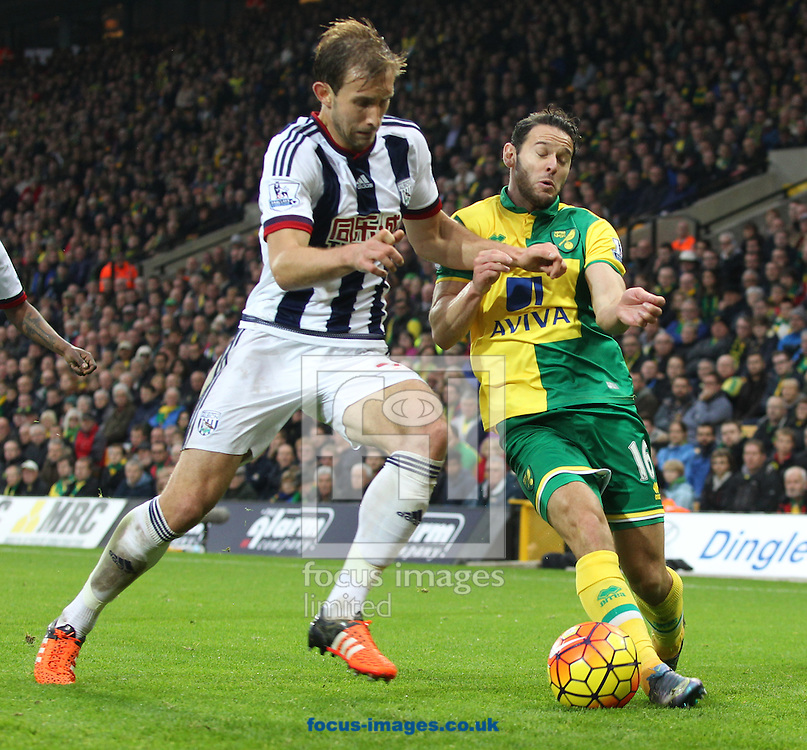 Craig Dawson of West Bromwich Albion and Matt Jarvis of Norwich in action during the Barclays Premier League match at Carrow Road, Norwich<br /> Picture by Paul Chesterton/Focus Images Ltd +44 7904 640267<br /> 24/10/2015