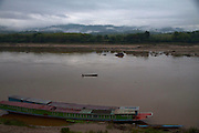 A lone fisherman casts his net out just after dawn in the expansive Mekong River in the Lao town of Paklay.