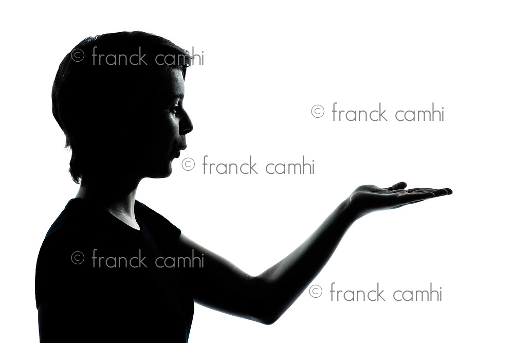 one caucasian young teenager silhouette girl empty hands open portrait in studio cut out isolated on white background