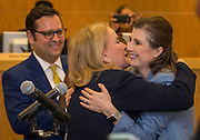 Holly Maria Flynn Vilaseca Ocampo hugs Sylvia Garcia after taking the oath of office to become Houston ISD Trustee for District VI, January 12, 2017.