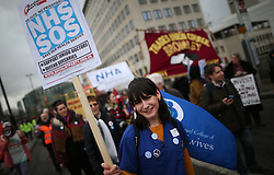 © Licensed to London News Pictures. 09/01/2016. London, UK. A junior nurse takes part in a rally against the proposed cancellation of bursaries for nurses hoping to train for work in the NHS.  Photo credit: Peter Macdiarmid/LNP