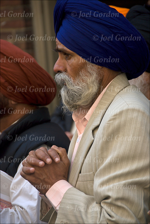 "Before the start of the Sikh Day Parade in New York City, Sikhs praying and chanting the  name of g-d or the wonderful g-d ""Wahe Guru""."