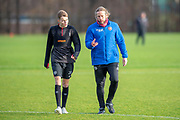 Austin MacPhee, assistant manager of Heart of Midlothian (right) chats with Harry Cochrane (#20) of Heart of Midlothian during training ahead of the visit of Rangers in the Scottish Premiership on 1st December 2018, at Oriam Sports Performance Centre, Riccarton, Scotland on 30 November 2018.