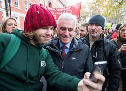 © Licensed to London News Pictures. 04/11/2015. London, UK.  JOHN MCDONNELL poses for a selfie as Demonstrators clash with police as Thousands of students take part in a demonstration in central London against tuition fees. The rally which starts outside the University of London Union, will feature a speech from Shadow Chancellor John McDonnell.  Photo credit: Ben Cawthra/LNP