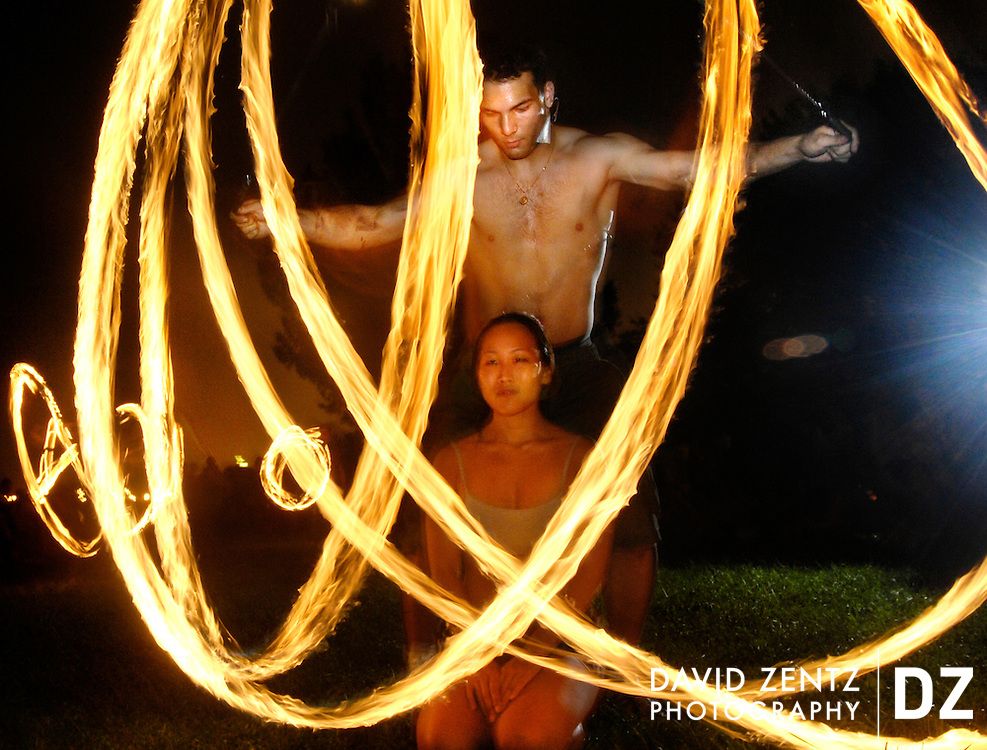 "PURCHASE THESE PHOTOS AT PJSTAR.COM DAVID ZENTZ/JOURNAL STAR.Erica Shin of Chicago gets what Van Roeyen refers to as a ""fire hug,"" during which he stands behind the recipient of the hug and spins fire poi around them, during the Full Moon Jam near Foster Beach in Chicago. ""I'm really frightened of fire, actually, so this was an interesting experience"" she says."