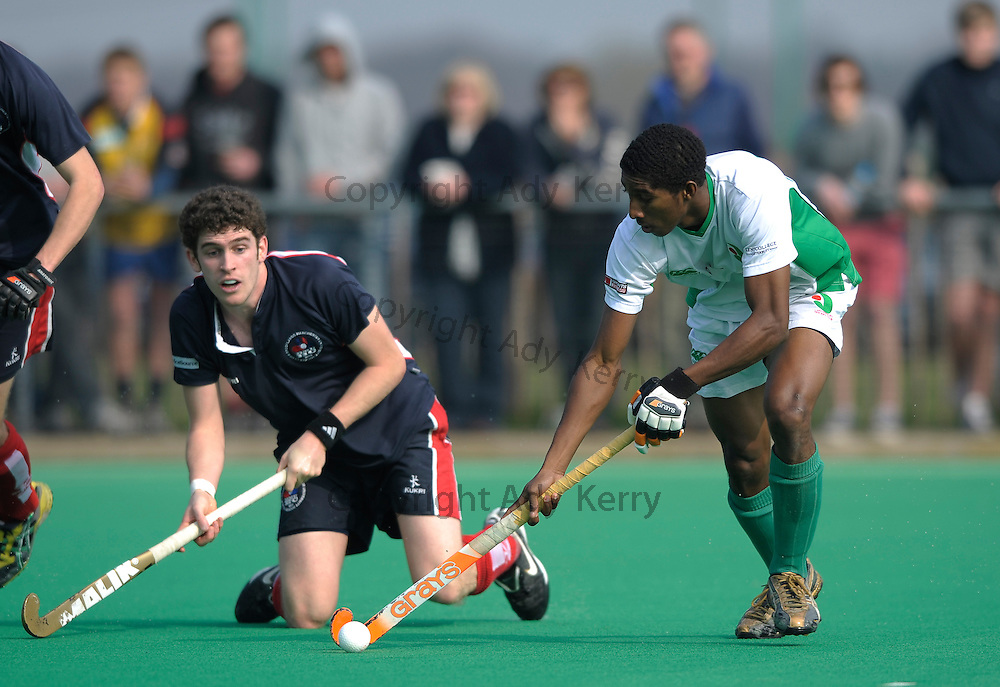 Canterbury's Mickell Pierre  (R) challenges with Brookland's Peter Friend during their England Hockey League Premier Division match at  Polo Farm, Canterbury, Kent, 27th March 2011.