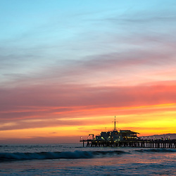 Santa Monica Pier at sunset panoramic picture along the Pacific Ocean in Southern California. Panorama photo ratio is 1:3. Copyright ⓒ 2017 Paul Velgos with All Rights Reserved.