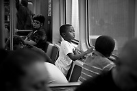 Shaquille Wilson, 5, looks out the window as the Pink Line passes through Pilsen, a neighborhood on Chicago's west side on Wednesday, June 27, 2018. At right is Wilson's cousin Michael Wilson, 4.<br />