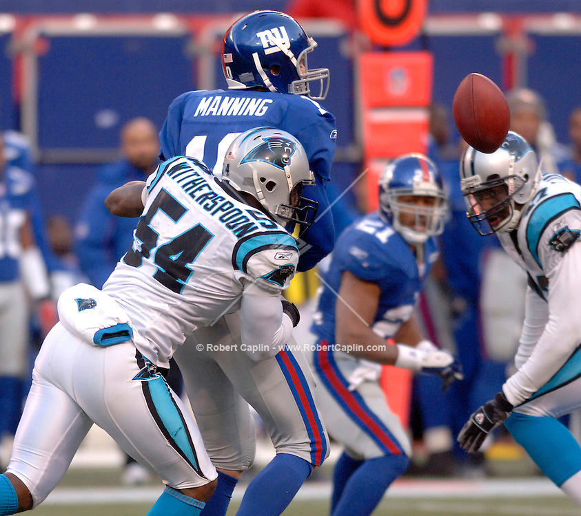 January 8, 2006 --  Carolina's Will Witherspoon sacks Eli Manning in the final minutes of the game, the result of which caused a fumble that carolina recovered during the New York Giants vs Carolina Panthers match-up at Giants Stadium.  Photo Credit: Robert Caplin For The New York Times