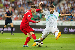 Bostjan Cesar of Slovenia and Jack Wilshere of England during the EURO 2016 Qualifier Group E match between Slovenia and England at SRC Stozice on June 14, 2015 in Ljubljana, Slovenia. Photo by Grega Valancic