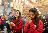 People pray with incense at the Thien Hau temple <br /> on the first day of Chinese Lunar New Year in Los Angeles, Feb 16, 2018. (Photo by Ringo Chiu)<br /> <br /> Usage Notes: This content is intended for editorial use only. For other uses, additional clearances may be required.