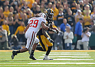 October 23 2010: Iowa Hawkeyes wide receiver Marvin McNutt (7) tries to avoid Wisconsin Badgers cornerback Niles Brinkley (29) during the first half of the NCAA football game between the Wisconsin Badgers and the Iowa Hawkeyes at Kinnick Stadium in Iowa City, Iowa on Saturday October 23, 2010. Wisconsin defeated Iowa 31-30.