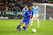 Leicester City midfielder Demarai Gray (7) on the attack during the quarter final of the EFL Cup match between Leicester City and Manchester City at the King Power Stadium, Leicester, England on 18 December 2018.