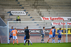 BLACKPOOL, ENGLAND - Wednesday, August 26, 2009: A builder gets a free view of Blackpool against Wigan Athletic during the League Cup 2nd Round match at Bloomfield Road. (Photo by David Rawcliffe/Propaganda)