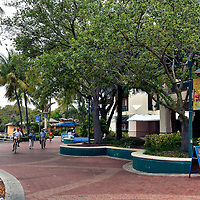 Riverwalk Promenade in Fort Lauderdale, Florida<br /> A growing trend among cities located along a waterway is to create a promenade that attracts locals and tourists but downtown Fort Lauderdale has done an exemplary job with their Riverwalk district.  It features several cultural centers, a historic neighborhood, plenty of bars and restaurants, a large park, shops and this brick walking path that stretches for a mile along the bank of the New River.