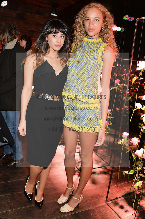 Left to right, singer FOXES (Louisa Allen) and PHOEBE COLLINGS JAMES at the Lancôme pre BAFTA party held at The London Edition, 10 Berners Street, London on 14th February 2014.