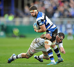 Guy Mercer (Bath) is tackled in possession - Photo mandatory by-line: Patrick Khachfe/JMP - Tel: Mobile: 07966 386802 06/04/2014 - SPORT - RUGBY UNION - The Recreation Ground, Bath - Bath Rugby v Brive - Amlin Challenge Cup.