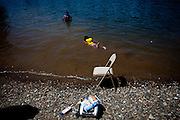 Children swim in the American River in Sacramento, Calif. on July 1, 2011. Budget cuts have closed many of Sacramento's public pools. The American River is a popular alternative, but a deep Sierra snowpack has led to cold, swift flows and many rescues by emergency personnel.