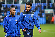 Oldham Athletic striker Aaron Holloway (10) and Oldham Athletic defender Dylan King (32)  before the EFL Sky Bet League 1 match between Peterborough United and Oldham Athletic at London Road, Peterborough, England on 20 January 2018. Photo by Nigel Cole.