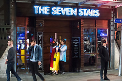 © Licensed to London News Pictures . 07/04/2017 . Manchester , UK . Two women check their costumes and makeup outside The Seven Stars pub on Dantzic Street as a Disney themed pub crawl passes through Manchester City Centre . Greater Manchester Police have authorised dispersal powers and say they will ban people from the city centre for 48 hours , this evening (7th April 2017) , in order to tackle alcohol and spice abuse . Photo credit : Joel Goodman/LNP