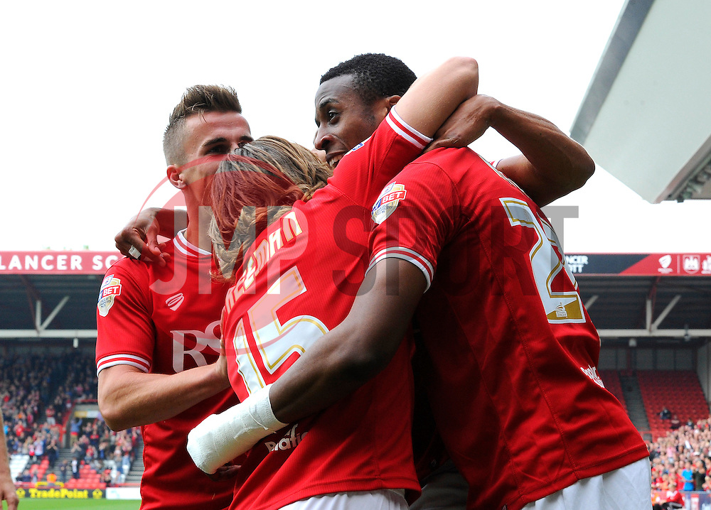 Jonathan Kodjia of Bristol City celebrates his goal with Bobby Reid, Luke Freeman and Joe Bryan   - Mandatory byline: Joe Meredith/JMP - 07966 386802 - 03/10/2015 - FOOTBALL - Ashton Gate - Bristol, England - Bristol City v MK Dons - Sky Bet Championship