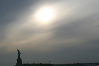 Evening sunlight over the Statue of Liberty, New York, USA
