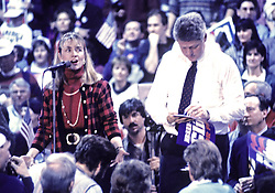 "Governor Bill Clinton (Democrat of Arkansas), right, and his wife, Hillary Rodham Clinton, left, at a campaign rally at Fairgrounds Junior High School in Nashua, NH, USA, on February 16, 1992. The Clintons were campaigning in advance of New Hampshire's ""First in the Nation"" presidential primary. Photo by Ron Sachs/CNP/ABACAPRESS.COM"