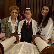 Family and Cantor with Langston, Bat Mitzvah boy in synagogue in front of the Torah, the ceremony admitting Jewish boy as an adult into Jewish Community, at age 13.<br /> <br /> Langston Aaron Salz Gering -  Bar Mitzvah on 2/5/10