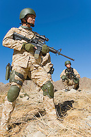 Two soldiers on patrol in field