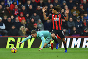 Aaron Ramsey (8) of Arsenal goes down under pressure from Nathan Ake (5) of AFC Bournemouth during the Premier League match between Bournemouth and Arsenal at the Vitality Stadium, Bournemouth, England on 25 November 2018.